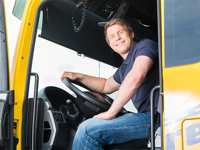 Man sitting by steering wheel